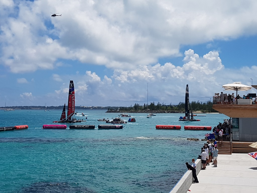 The victorious Emirates Team New Zealand just after winning the final race - view from the Gosling's Rum Stand
