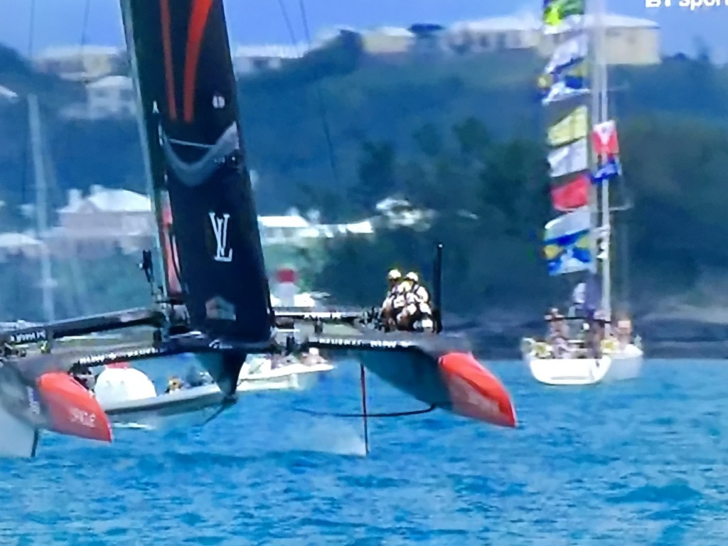 Heartbeat IV flying her flags close to the action at the 35th America's Cup